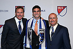 14 January 2016: Andrew Tarbell (center), with general manager John Doyle (left) and head coach Dominic Kinnear (right), was taken with the #8 overall pick by the San Jose Earthquakes. The 2016 MLS SuperDraft was held at The Baltimore Convention Center in Baltimore, Maryland as part of the annual NSCAA Convention.