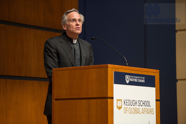"""April 4, 2016; Rev. John I. Jenkins, C.S.C., president of the University of Notre Dame, gives the welcome at the inaugural conference, """"For the Planet and the Poor, """" of the Keough School of Global Affairs in the Jordan Auditorium.  (Photo by Barbara Johnston/University of Notre Dame)"""