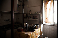 Inside the Red Zone, cordoning off the medieval center of L'Aquila. The interiors of the houses, fled on a deadly night of six years ago, still show the signs of an abruptly interrupted life. In most kitchens, pots, pans, dishes and all type of cookware still lies as it was left that night. L'Aquila, Italy. Apr. 10, 2015