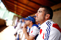 24 June 2011: Pierrick Le Mestre of Team France. Illustration of a photographic essay called Life in the dugout, during France 8-5 win over UCLA Alumni, at the 2011 Prague Baseball Week, in Prague, Czech Republic.