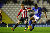 1st November 2017, St. Andrews Stadium, Birmingham, England; EFL Championship football, Birmingham City versus Brentford; David Davis of Birmingham City fends off Ryan Woods of Brentford