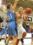 SIOUX FALLS, SD - DECEMBER 5:  Amber Paden #42 from the University of Sioux Falls looks to the basket around Olivia Winkler #44 from Upper Iowa in the first half of their game Friday night at the Stewart Center.  (Photo by Dave Eggen/inertia)