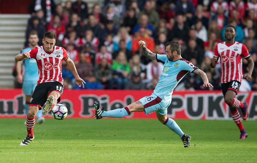 Southampton's Dusan Tadic gets to the ball ahead of Burnley's Steven Defour<br /> <br /> Photographer James Williamson/CameraSport<br /> <br /> The Premier League - Southampton v Burnley - Sunday 16th October 2016 - St Mary's Stadium - Southampton<br /> <br /> World Copyright &copy; 2016 CameraSport. All rights reserved. 43 Linden Ave. Countesthorpe. Leicester. England. LE8 5PG - Tel: +44 (0) 116 277 4147 - admin@camerasport.com - www.camerasport.com