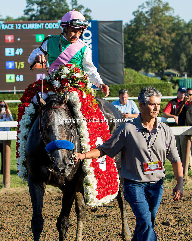SARATOGA SPRINGS - AUGUST 27: Arrogate #1, ridden by Mike Smith, is led to the winner's circle after winning the the Travers Stakes on Travers Stakes Day at Saratoga Race Course on August 27, 2016 in Saratoga Springs, New York. (Photo by Sue Kawczynski/Eclipse Sportswire/Getty Images)