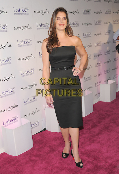 BROOKE SHIELDS.The Launch Party for Latisse held at 800 La Cienega in West Hollywood, California, USA..March 26th, 2009                                                                     full length black dress strapless hand on hip .CAP/DVS.©Debbie VanStory/Capital Pictures.
