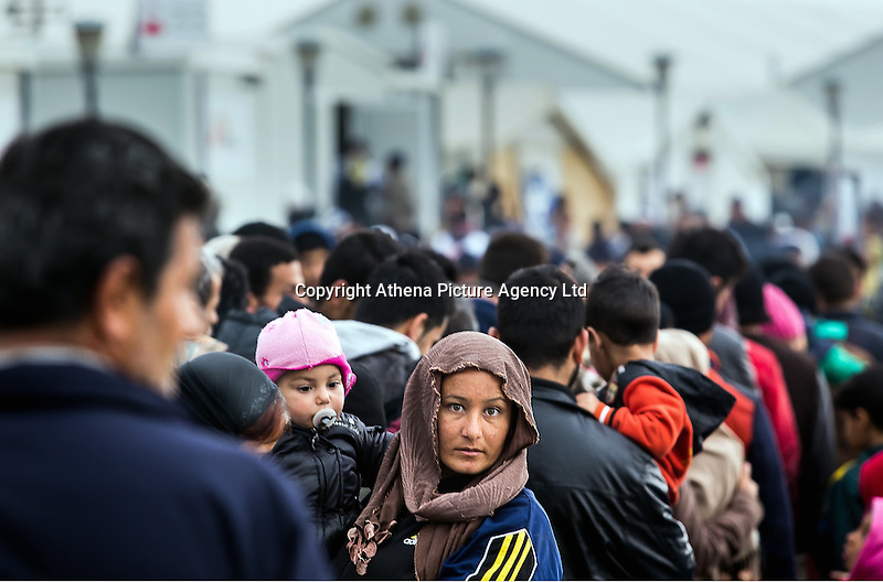 Pictured: Refugees by the border Monday 29 February 2016<br /> Re: A crowd of migrants has burst through a barbed-wire fence on the FYRO Macedonia-Greece border using a steel pole as a battering ram.<br /> TV footage showed migrants pushing against the fence at Idomeni, ripping away barbed wire, as FYRO Macedonian police let off tear gas to force them away.<br /> A section of fence was smashed open with the battering ram. It is not clear how many migrants got through.<br /> Many of those trying to reach northern Europe are Syrian and Iraqi refugees.<br /> About 6,500 people are stuck on the Greek side of the border, as FYRO Macedonia is letting very few in. Many have been camping in squalid conditions for a week or more, with little food or medical help.