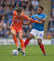 Portsmouth's Nathan Thompson (right) vies for possession with Shrewsbury Town's Alex Gilliead (left) <br /> Photographer David Horton/CameraSport<br /> <br /> The EFL Sky Bet League One - Portsmouth v Shrewsbury Town - Saturday September 8th 2018 - Fratton Park - Portsmouth<br /> <br /> World Copyright &copy; 2018 CameraSport. All rights reserved. 43 Linden Ave. Countesthorpe. Leicester. England. LE8 5PG - Tel: +44 (0) 116 277 4147 - admin@camerasport.com - www.camerasport.com