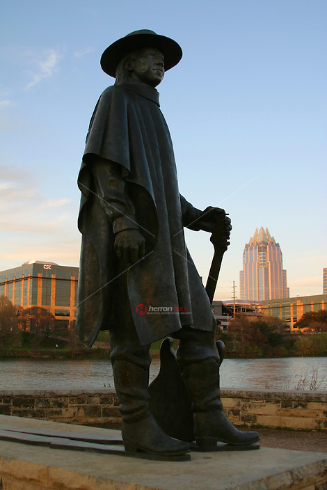 A statue memorializes blues guitarist Stevie Ray Vaughan in Town Lake, Austin, Texas.