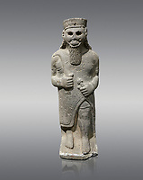 Hittite baslat sculptute of a male, late Hittite Period - 900-700 BC. Adana Archaeology Museum, Turkey. Against a grey background