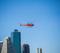 A sightseeing helicopter departs the Downtown Heliport in New York on Saturday, June 25, 2016. (© Richard B. Levine)