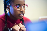 NWA Democrat-Gazette/CHARLIE KAIJO Bentonville High School student Imana Junior, 15, works on an essay, Monday, February 12, 2018 at the Boys and Girls Club in Bentonville. <br />