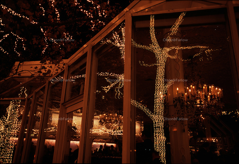 Lights reflect into the restaurant Tavern on the Green in Central Park.