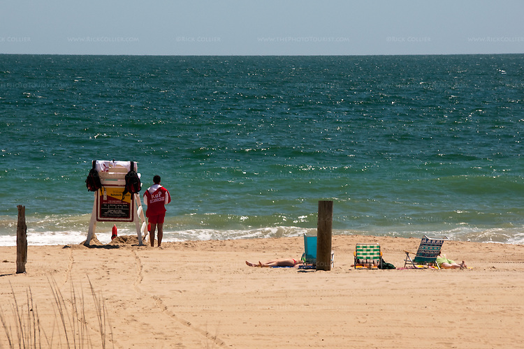 Fresh paint and drag marks in the sand show that the lifeguards are just beginning to set up their summer stations, in the spring on the beach at Rehoboth Beach, Delaware, USA.