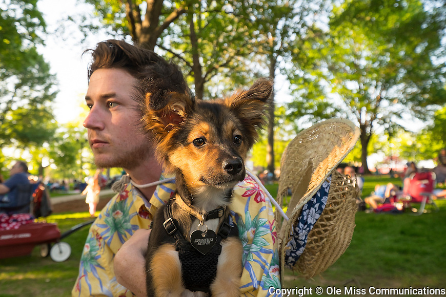 Andrew McFann and his dog Chief Stefanie enjoy the band Iron & Wine in the Grove. Photo by Robert Jordan/Ole Miss Communications