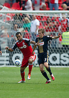 Toronto FC forward Maicon Santos #29 and Philadelphia Union midfielder Brian Carroll #7 in action during an MLS game between the Philadelphia Union and the Toronto FC at BMO Field in Toronto on May 28, 2011..The Philadelphia Union won 6-2..