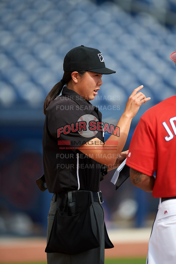 Home plate umpire Emma Charlesworth-Seiler goes over the ground rules during the lineup exchange before the first game of a doubleheader between the GCL Mets and GCL Nationals on July 22, 2017 at The Ballpark of the Palm Beaches in Palm Beach, Florida.  GCL Mets defeated the GCL Nationals 1-0 in a seven inning game that originally started on July 17th.  (Mike Janes/Four Seam Images)