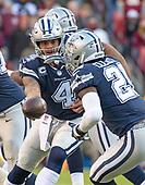 Dallas Cowboys quarterback Dak Prescott (4) hands off to running back Ezekiel Elliott (21) in first quarter action against the Washington Redskins at FedEx Field in Landover, Maryland on Sunday, October 21, 2018.<br /> Credit: Ron Sachs / CNP