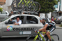 COLOMBIA. 09-08-2014. Claudio Corti (Izq) da instrucciones a Fabio Duarte (#155) durante la etapa 4, Nobsa – Duitama – Paipa – Tunja – Chía – Cota – 198.7 Km, de la Vuelta a Colombia 2014 en bicicleta que se cumple entre el 6 y el 17 de agosto de 2014. / Claudio Corti (L) gives directions to Fabio Duarte (#155) during the stage 4, Nobsa – Duitama – Paipa – Tunja – Chía – Cota – 198.7 Km, of the Tour of Colombia 2014 in bike holds between 6 and 17 of August 2014. Photo:  VizzorImage/ José Miguel Palencia / Str