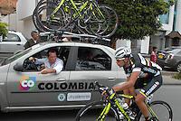 COLOMBIA. 09-08-2014. Claudio Corti (Izq) da instrucciones a Fabio Duarte (#155) durante la etapa 4, Nobsa – Duitama – Paipa – Tunja – Chía – Cota – 198.7 Km, de la Vuelta a Colombia 2014 en bicicleta que se cumple entre el 6 y el 17 de agosto de 2014. / Claudio Corti (L) gives directions to Fabio Duarte (#155) during the stage 4, Nobsa – Duitama – Paipa – Tunja – Chía – Cota – 198.7 Km, of the Tour of Colombia 2014 in bike holds between 6 and 17 of August 2014. Photo:  VizzorImage/ José Miguel Palencia / Str