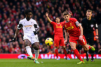 Sunday, 23 February 2014<br /> Pictured: Swansea City's Wilfried Bony and Liverpool's Steven Gerrard<br /> Re: Barclay's Premier League, Liverpool FC v Swansea City FC v at Anfield Stadium, Liverpool Merseyside, UK.