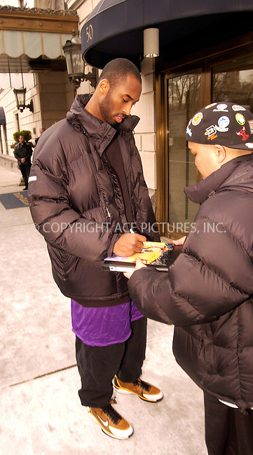WWW.ACEPIXS.COM . . . . .  ....NEW YORK, FEBRUARY 8, 2005....Kobe Bryant takes a moment to sign an autograph and pose for a picture with a fan outside the Ritz-Carlton.....Please byline: Ian Wingfield - ACE PICTURES..... *** ***..Ace Pictures, Inc:  ..Philip Vaughan (646) 769-0430..e-mail: info@acepixs.com..web: http://www.acepixs.com