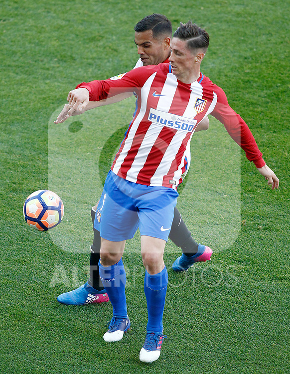 Atletico de Madrid's Fernando Torres (r) and Sevilla FC's Gabriel Mercado during La Liga match. March 19,2017. (ALTERPHOTOS/Acero)