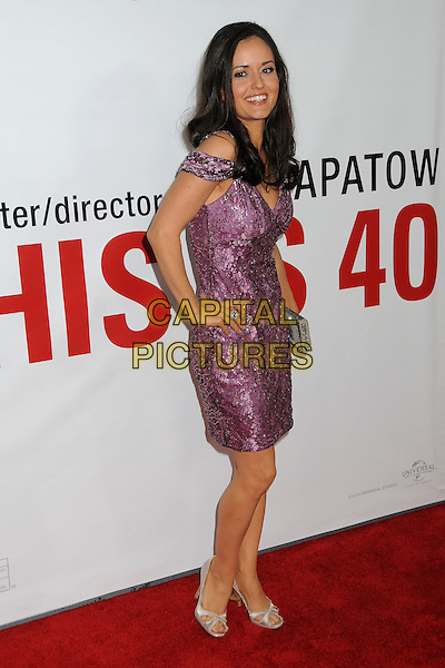 "Danica McKellar.""This Is 40"" Los Angeles Premiere held at Grauman's Chinese Theatre, Hollywood, California, USA..December 12th, 2012.full length dress hand on hip silver clutch bag floral print purple beads beaded off the shoulder side .CAP/ADM/BP.©Byron Purvis/AdMedia/Capital Pictures."