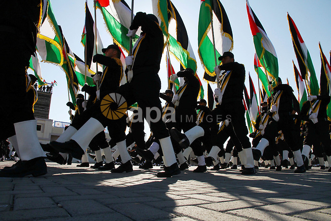 Palestinian Hamas security men march during a graduation ceremony of a military training course of the ministry of interior in Gaza City on 27 December 2011. Photo by Ashraf Amra.