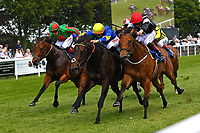 Red Alert yellow ridden by Joesephine Gordon and Secret Agent ridden by George Wood battle out the finish of The Sharp's Doom Bar Handicap during Afternoon Racing at Salisbury Racecourse on 13th June 2017