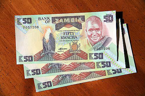 3 Zambian 50 kwacha currency bills on table