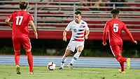 GEORGETOWN, GRAND CAYMAN, CAYMAN ISLANDS - NOVEMBER 19: Daniel Lovitz #5 of the United States looks for an open man downfield during a game between Cuba and USMNT at Truman Bodden Sports Complex on November 19, 2019 in Georgetown, Grand Cayman.