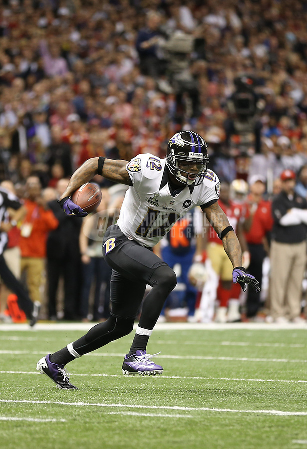 Feb 3, 2013; New Orleans, LA, USA; Baltimore Ravens wide receiver Jacoby Jones (12) runs against the San Francisco 49ers to score a touchdown in the second quarter in Super Bowl XLVII at the Mercedes-Benz Superdome. Mandatory Credit: Mark J. Rebilas-