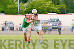Shane Curtin St Kieran's under pressure from Daniel O'Leary Kilcummin in action in Brosna on sunday