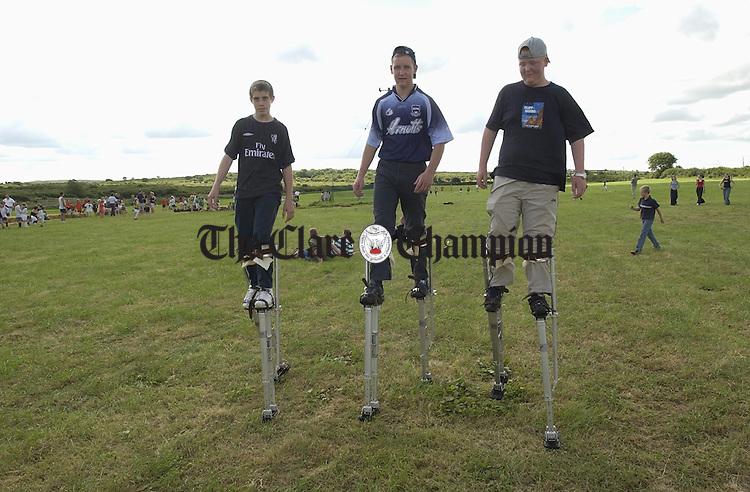 Stilt walkers, David Murphy, John Mc Grath  and David Mc Grath entertain the crowd at the Burren Festival in Carron. Photograph by John Kelly.