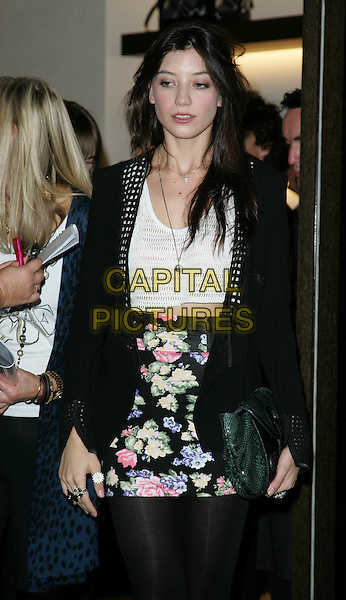DAISY LOWE.Vogue 'Fashion's Night Out ' launch at Burberry's store in New Oxford Street, London, England..September 10th 2009.half length black tights cardigan skirt tights top floral print skirt white green clutch bag .CAP/ROS.©Steve Ross/Capital Pictures.