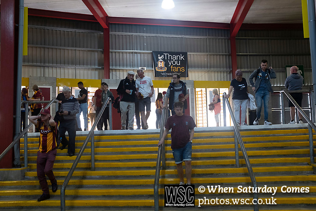 Bradford City 3, Carlisle United 1, 21/09/2019. Valley Parade, EFL League 2. Home supporters entering via turnstiles under the main stand before Bradford City played Carlisle United in a Skybet League 2 fixture at Valley Parade. The home team were looking to bounce back after being relegated during a disastrous 2018-19 season on and off the pitch. Bradford won the match 3-1, watched by a crowd of 14, 217. Photo by Colin McPherson.