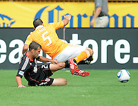 DC United defender Daniel Woolard (21) makes a tackle against Houston Dynamo midfielder Danny Cruz (5)   Houston Dynamo tied DC United 2-2, at RFK Stadium, Saturday June 25, 2011.