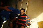 Sirte, LIBYA: Monday 11th October 2011:..A man suspected of being a Gaddafi loyalist soldier, center, questioned by rebel fighters. ..Ayman Oghanna