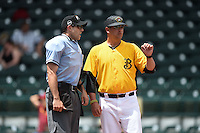 Bradenton Marauders manager Michael Ryan (16) talks with umpire Alex Mackay in between innings during a game against the St. Lucie Mets on April 12, 2015 at McKechnie Field in Bradenton, Florida.  Bradenton defeated St. Lucie 7-5.  (Mike Janes/Four Seam Images)