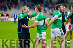 Legion Manager Peter Keane and James O'Dnoghue celebrate after defeating Rathmore in the semi-final of the County Senior Football Championship at Fitzgerald Stadium on Sunday.