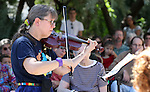 Sue Kitts-Jesch leads the Carson City Symphony Strings in the Summer performance Thursday, Aug. 4, 2011 at Sierra Place Senior Living in Carson City, Nev.  .Photo by Cathleen Allison
