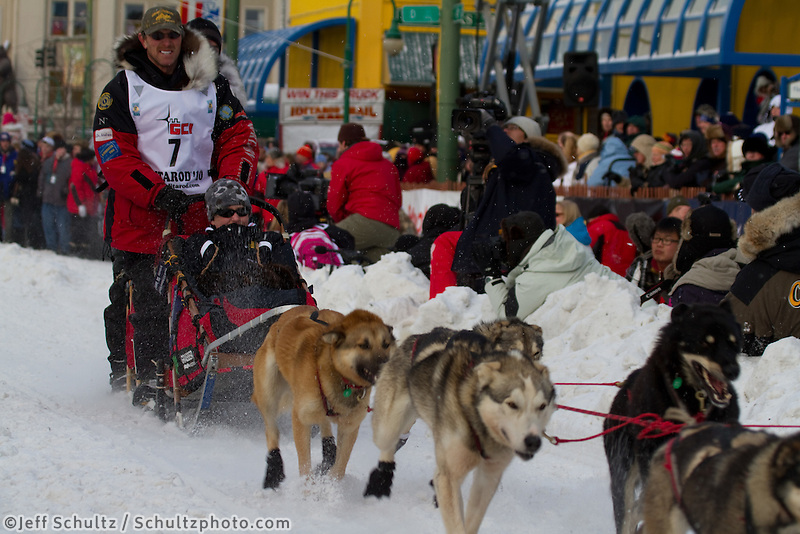 2010 Iditarod Ceremonial Start in Anchorage Alaska musher # 7 PAUL GEBHARDT with Iditarider CHRISTIAN FOX