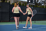 Emma Davis (right) of the Wake Forest Demon Deacons shakes hands with doubles partner Chandler Carter after winning a point during the match against the North Carolina Tar Heels at the Wake Forest Tennis Center on March 29, 2017 in Winston-Salem, North Carolina. The Tar Heels defeated the Demon Deacons 6-1.  (Brian Westerholt/Sports On Film)