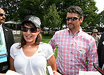 Former Governor of Alaska Sarah Palin and husband Todd in the paddock to see First Dude run in the 142nd  Belmont Stakes Day  at Belmont Park Racetrack, Elmont, New York.
