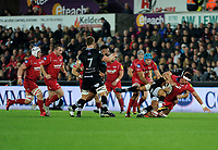 Scarlets' Aaron Shingler is tackled by Ospreys' James King<br /> <br /> Photographer Ashley Crowden/CameraSport<br /> <br /> Guinness Pro14 Round 6 - Ospreys v Scarlets - Saturday 7th October 2017 - Liberty Stadium - Swansea<br /> <br /> World Copyright &copy; 2017 CameraSport. All rights reserved. 43 Linden Ave. Countesthorpe. Leicester. England. LE8 5PG - Tel: +44 (0) 116 277 4147 - admin@camerasport.com - www.camerasport.com