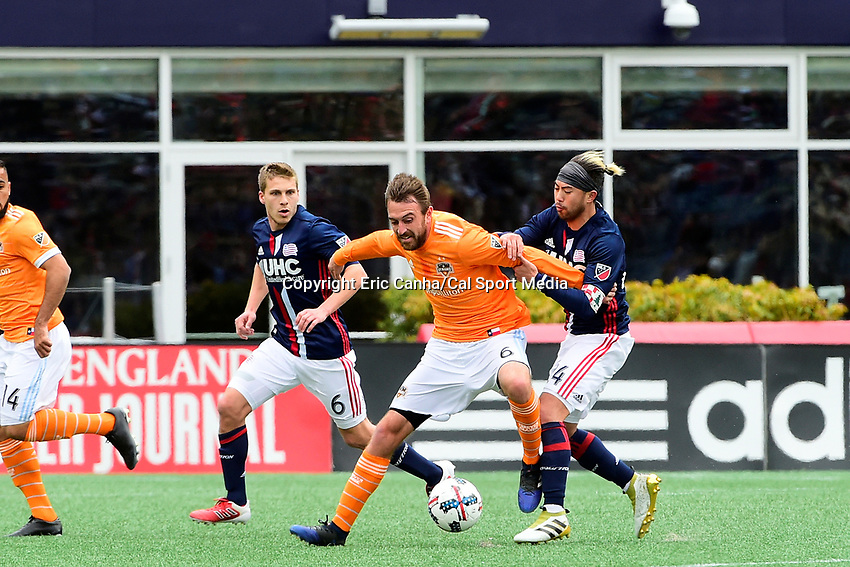 Saturday, April 8, 2017: Houston Dynamo midfielder Eric Alexander (6) battles between New England Revolution midfielder Scott Caldwell (6) and forward Diego Fagundez (14) for control of the ball during the MLS game between Houston Dynamo and the New England Revolution held at Gillette Stadium in Foxborough Massachusetts. New England defeats Houston 2-0. Eric Canha/CSM