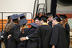 Terryville, CT- 21 June  2017-062117CM09-  Terryville High School graduates including Jake Borda, center, huddle around during commencement exercises in Terryville on Wednesday.  Christopher Massa Republican-American