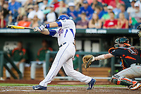 Florida Gators first baseman Peter Alonso (20) swings the bat against the Miami Hurricanes in the NCAA College World Series on June 13, 2015 at TD Ameritrade Park in Omaha, Nebraska. Florida defeated Miami 15-3. (Andrew Woolley/Four Seam Images)