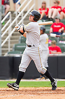 Justin Howard #7 of the West Virginia Power follows through on his swing against the Kannapolis Intimidators at Fieldcrest Cannon Stadium on April 20, 2011 in Kannapolis, North Carolina.   Photo by Brian Westerholt / Four Seam Images