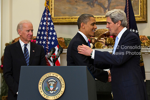 With Vice President Joe Biden looking on, left, United States President Barack Obama (C) nominates U.S. Senator John Kerry (Democrat of Massachusetts), right, to be the next Secretary of State in the Roosevelt Room of the White House in Washington, DC, USA, 21 December 2012. If confirmed, Kerry will replace retiring Secretary of State Hillary Clinton early in 2013..Credit: Jim LoScalzo / Pool via CNP